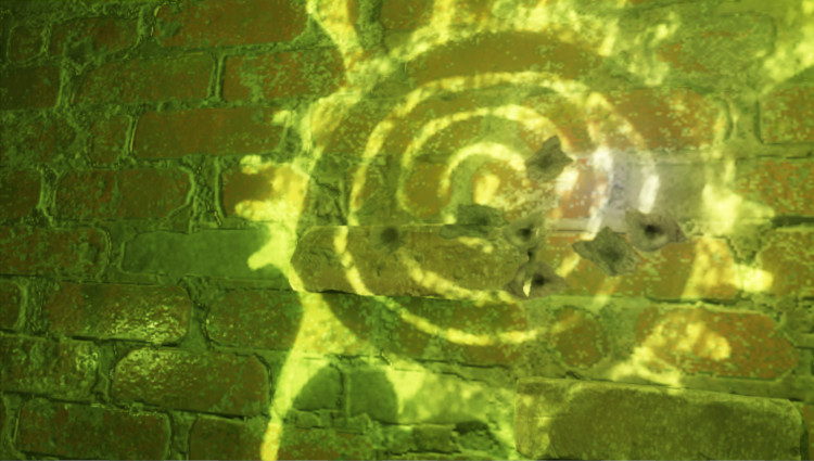 A screenshot from the game Half-Life: Alyx, showing a brick wall where a representation of one of the game's enemies has been created with glowing green paint. Several bullet holes are also visible in the bricks.
